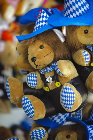 MUNICH, GERMANY - SEPTEMBER 21: soft toy as souvenir at world biggest beer festival -Oktoberfest in Munich- on September  21, 2011 in Munich, Germany