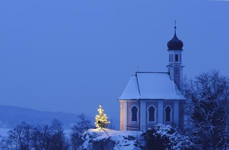 evening church: christmas chapel at evening with illuminated tree