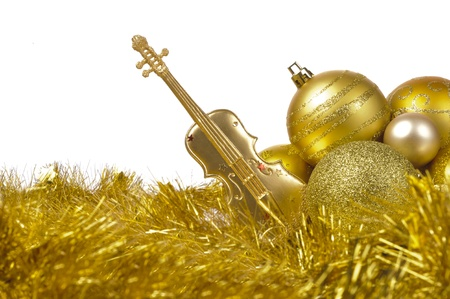 golden chritmas balls and violin photo