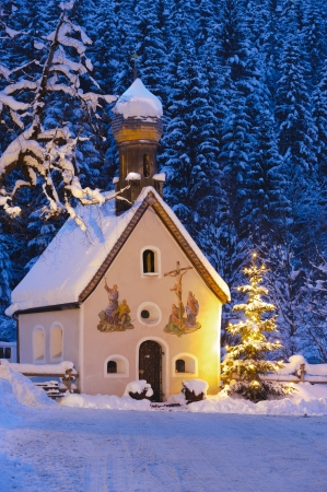 chapel: christmas church with tree at evening
