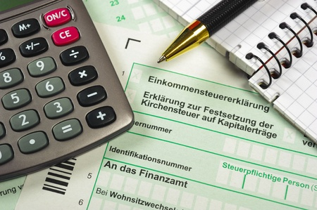 tax return: german tax form with calculator Stock Photo