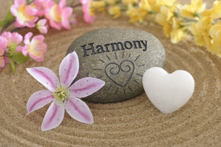 and harmony: zen stone of harmony in sand