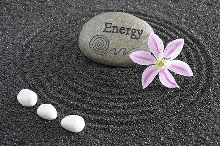 zen garden with stone of energy photo