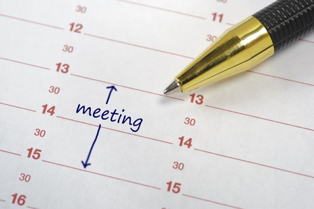 daily planner: meeting date in calendar Stock Photo