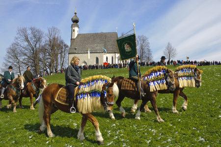 pilgrim costume: TRAUNSTEIN, GERMANY - APRIL 9: biggest annual catholic horse procession at easter, named - Osterritt - Georgiritt - in bavarian city Traunstein with 400 horses at April 9, 2012 in Traunstein,