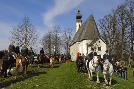 pilgrim costume: TRAUNSTEIN, GERMANY - APRIL 9: biggest annual catholic horse procession at easter, named - Osterritt - Georgiritt - in bavarian city Traunstein with 400 horses at April 9, 2012 in Traunstein,