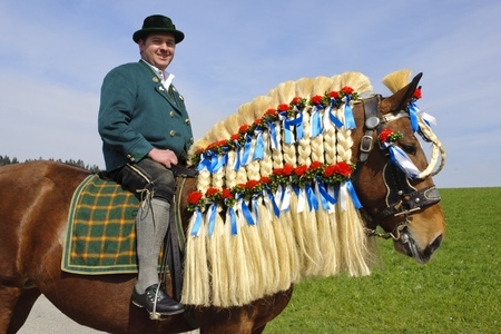 TRAUNSTEIN, GERMANY - APRIL 9: biggest annual catholic horse procession at easter, named - Osterritt - Georgiritt - in bavarian city Traunstein with 400 horses at April 9, 2012 in Traunstein,  Stock Photo - 13154584