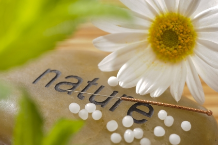 plant medicine:  alternative medicine with homeopathy, globules and acupunkture Stock Photo