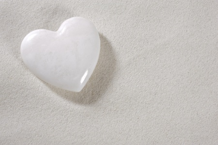 white heart in white sand Stock Photo - 13273092