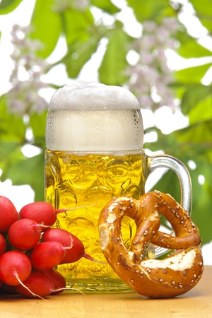 glass of german bavarian beer at munich octoberfest with radish and pretzel Stock Photo - 13723846