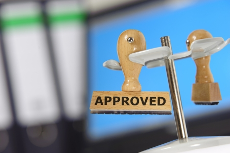 rubber stamp in office marked with approved Stock Photo - 13854440