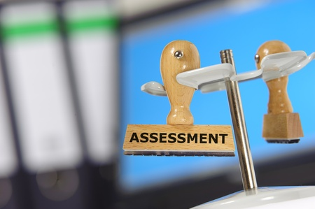 rubber stamp marked with assessment photo