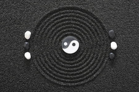 zen garden with stone of yin and yang photo