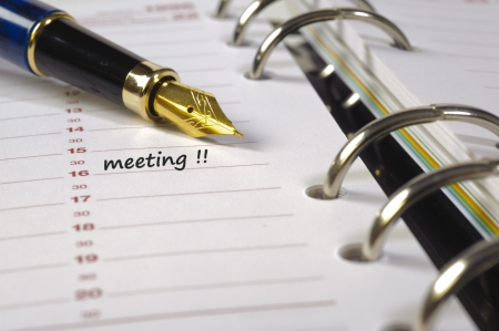 meeting date written in time planner photo