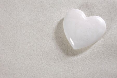 white heart in white sand photo
