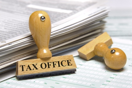 tax law: financial documents and rubber stamp marked with tax office Stock Photo