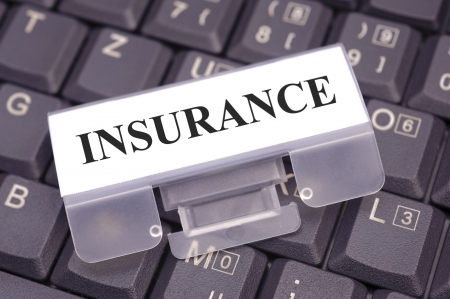 memo on keyboard marked with insurance photo
