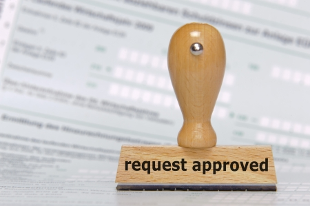 permission: rubber stamp marked with request approved Stock Photo