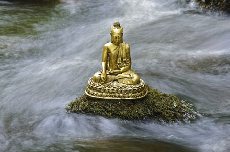 chinese buddha: chinese buddha sculpture sitting in flowing water cascade