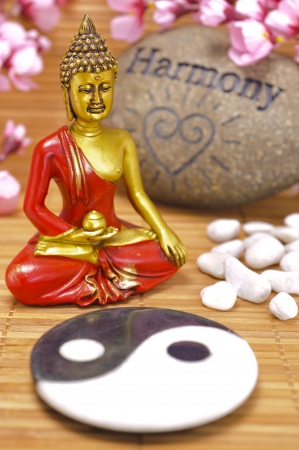 feng: sculpture of buddha with stone of harmony yin and yang
