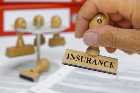 financial insurance: rubber stamp marked with insurance