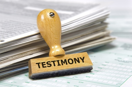 rubber stamp marked with testimony photo