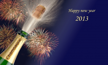 popping champagne with firework at new year 2013 photo