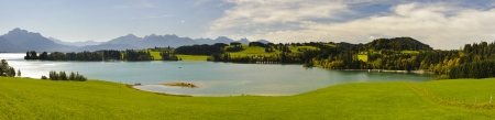 wide panorama view over a lake to alps mountains in bavaria, germany photo