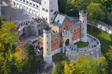 SCHWANGAU, GERMANY - OCT 6: landmark castle Neuschwanstein in Bavaria is a famous sightseeing for visitors in autumn on October 6, 2012 in Schwangau, Germany