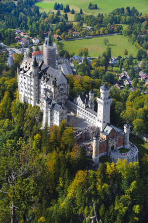 schwangau: SCHWANGAU, GERMANY - OCT 6: landmark castle Neuschwanstein in Bavaria is a famous sightseeing for visitors in autumn on October 6, 2012 in Schwangau, Germany