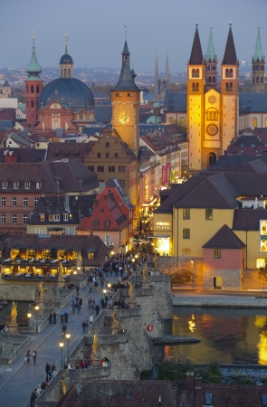 WUERZBURG, GERMANY - OCT 20: the historical skyline and the old stone bridge of medieval city Wuerzburg is romantic illuminated at night on October 20, 2012 in Wuerzburg, Germany