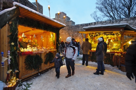 Romantic Christmas market with illuminated shops for gift and decoration on December 2, 2012 in Pappenheim, Bavaria, Germany  Stock Photo - 16768234