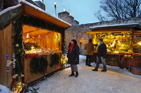 Romantic Christmas market with illuminated shops for gift and decoration on December 2, 2012 in Pappenheim, Bavaria, Germany  Stock Photo - 16768232