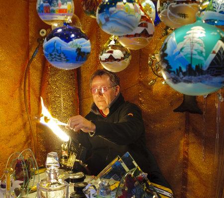 glassblower: BAD HINDELANG, GERMANY - DECEMBER 4: Romantic Christmas market with illuminated shop of glassblower and bowls on December 4, 2012 in Bad Hindelang, Bavaria, Germany