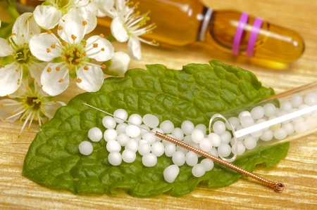 acus: alternative medicine with globule and acupuncture Stock Photo