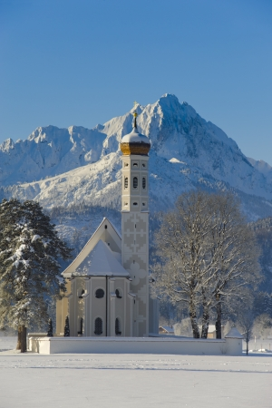 famous church St  Coloman nearby city fuessen in germany, bavaria, at winter in snow photo