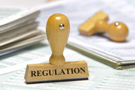 regel: rubber stempel gemarkeerd met regelgeving