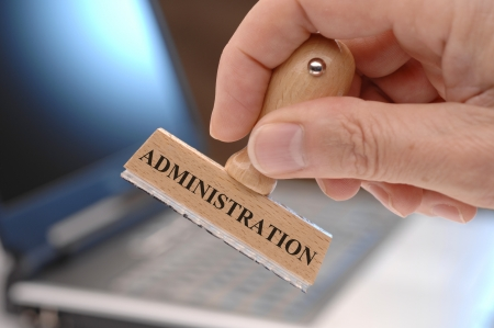 by admin: rubber stamp in hand marked with administration