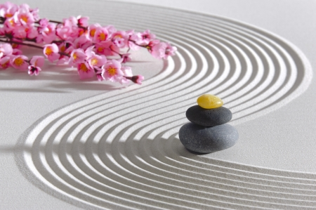 Japan zen garden of meditation with stone and structure in sand photo