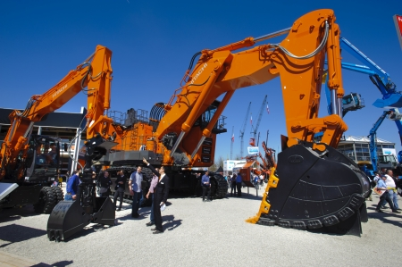 titled: MUNICH, GERMANY - APRIL 15: the world biggest trade fair for building machines, titled BAUMA 2013, takes place with 3400 exhibitors from 57 nations from 15.-21. April 2013 in Munich, Germany