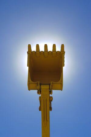 power shovel: single digger shovel isolated on blue sky