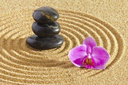 Japanese ZEN garden with stacked stones in sand photo