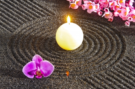 zen flower: Japanese ZEN garden with candle light in sand Stock Photo