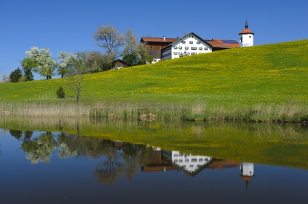 landscape with farm house and chapel in bavaria, germany photo
