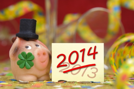 pig with clover leaf as talisman for new year 2014 Stock Photo - 19666956