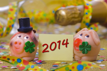 pig with clover leaf as talisman for new year 2014 photo