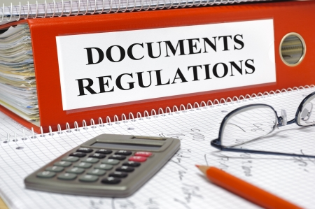 rules: folder marked with documents and regulations  Stock Photo