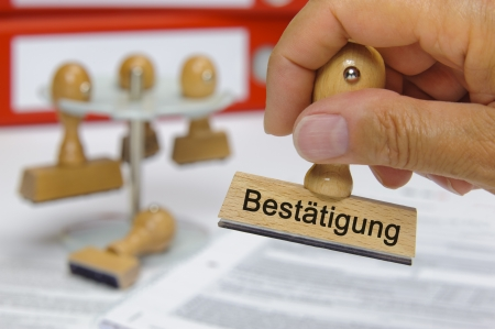 rubber stamp marked with Bestätigung - german word for confirmation photo