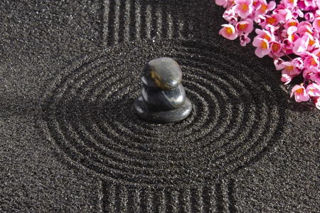 Japan garden with stacked stones in raked sand Stock Photo - 20302104