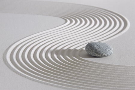 balance life: Japan garden with stone in raked sand
